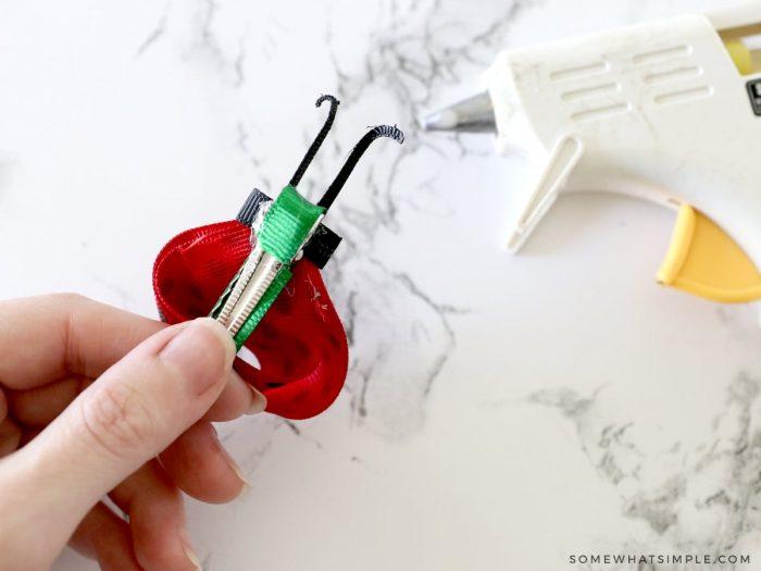 adding a ladybug bow to a clip