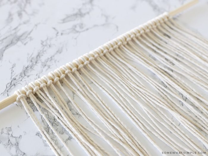 wood dowel with cotton rope hanging down