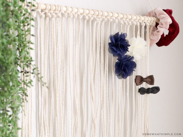 diy bow holder hanging on a wall