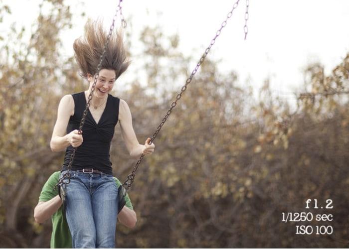 fast shutter speed with girl on swings