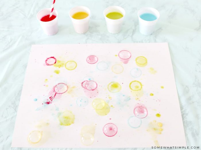 blowing bubbles onto paper