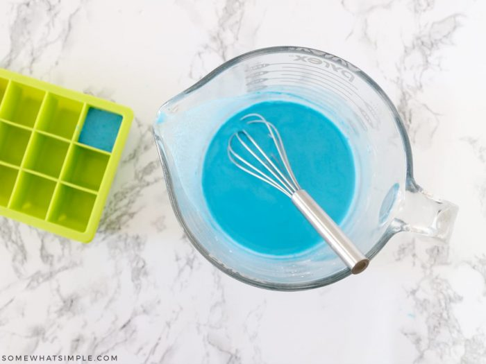 adding water to a glass measuring cup