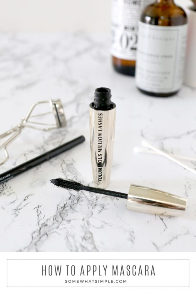 mascara and eyeliner on a white counter