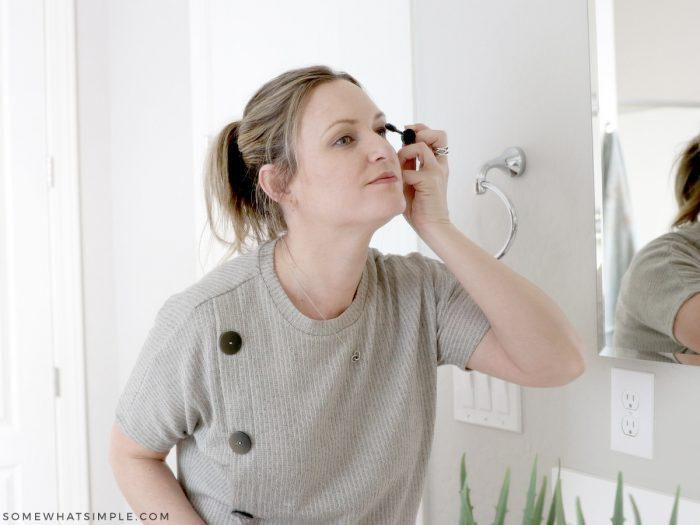 applying mascara in the mirror