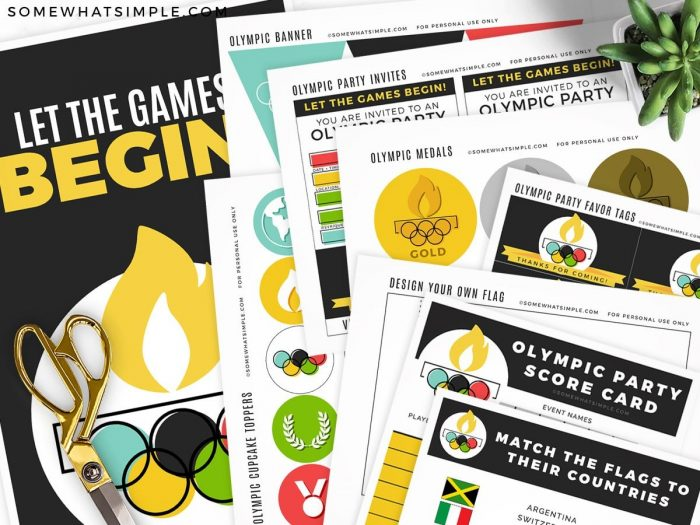 olympic party printables laid out on a counter