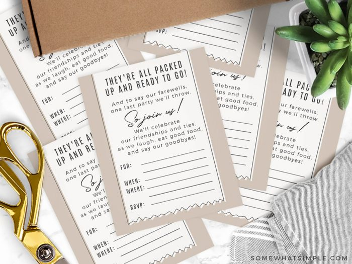 moving party invitations on a white counter