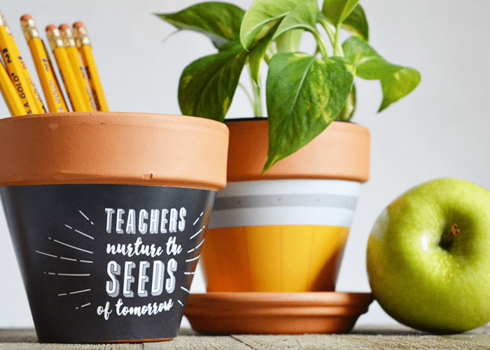 two terra cotta pots wrapped in paper to make a gift for the teacher