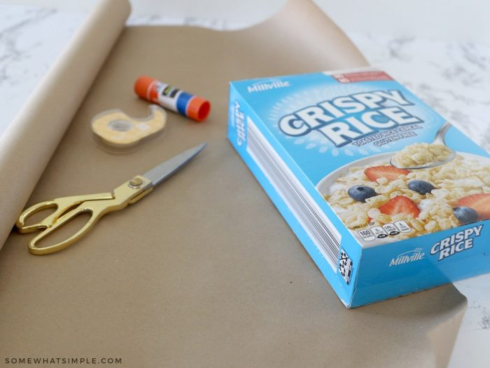 cutting paper to fit a cereal box